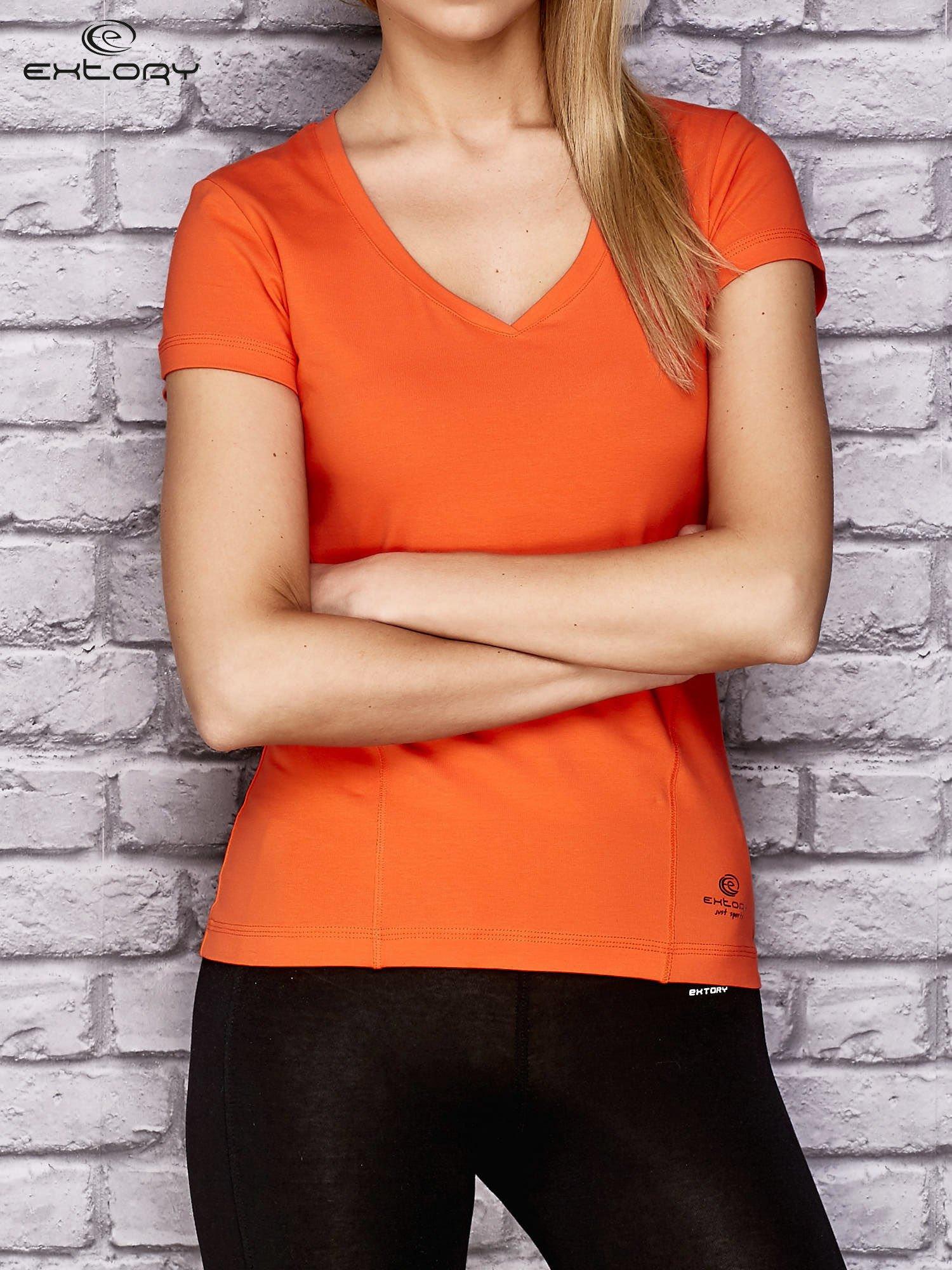 Dámské oranžové sportovní tričko s modelingovým prošíváním