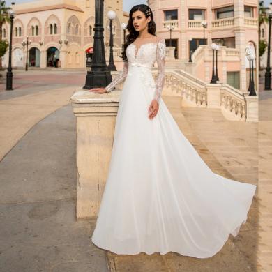 Moderní bílé krajkové svatební šaty s dlouhým rukávem
