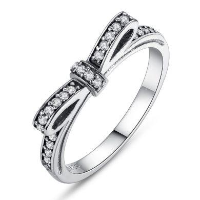 Stříbrný a zlatý prsten s mašlí a třpytivými kamínky