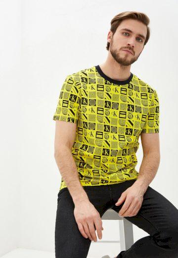 Calvin Klein pánské žluté tričko FLYER AOP RELAXED TEE